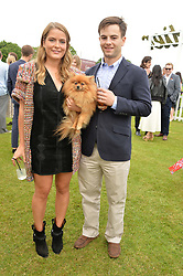 The HON.PHILIPPA CADOGAN, her dog Louis  and the HON.GEORGE CADOGAN at the Cartier Queen's Cup Polo final at Guard's Polo Club, Smiths Lawn, Windsor Great Park, Egham, Surrey on 14th June 2015