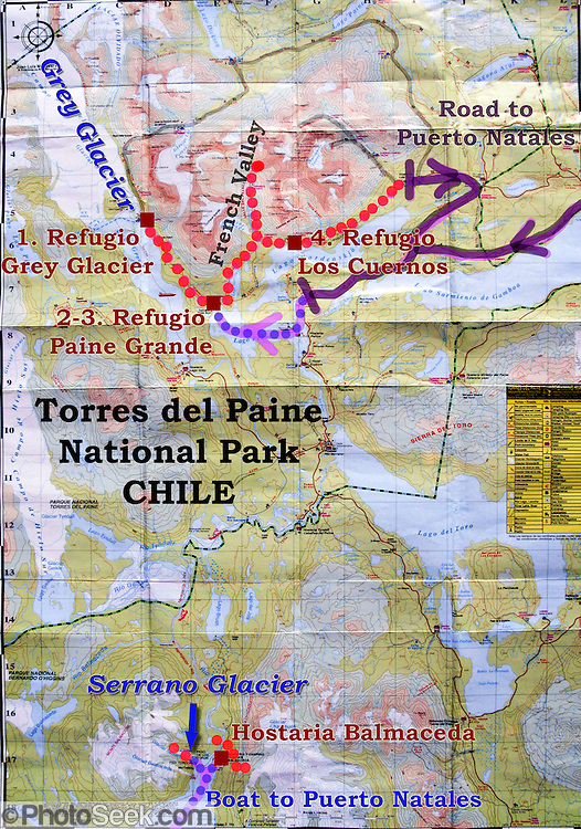 "In this map of Torres del Paine National Park (in Chile, South America), our hikes are shown as dotted red lines, including 5 days on the ""W Route"" and 2 days at Hostaria Balmaceda and the Serrano Glacier. The pink arrows with dotted blue lines are ferry routes. The purple lines are the park roads which connect to Puerto Natales off the map. In Chile, Patagonia includes the territory of Valdivia through Tierra del Fuego archipelago. In Chile, Patagonia includes the territory of Valdivia through Tierra del Fuego archipelago. Spanning both Argentina and Chile, the foot of South America is known as Patagonia, a name derived from coastal giants (""Patagão"" or ""Patagoni"" who were actually Tehuelche native people who averaged 25 cm taller than the Spaniards) who were reported by Magellan's 1520s voyage circumnavigating the world."