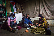 SUSIYA, PALESTINE - JUNE 14: A Palestinian family prepares food inside their tent in the West Bank village of Susiya in the occupied Palestinian territories on June 14, 2015. Their home is one of many residential tents in Susiya that is due to be demolished by Israel's Civil Administration.