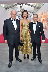 Left to right, NICHOLAS COLERIDGE, ALEXA CHUNG and JONATHAN NEWHOUSE at British Vogue's Centenary Gala Dinner in Kensington Gardens, London on 23rd May 2016.