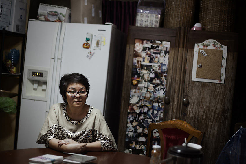 April 2013 - Mrs Suporn Rujapan in her kitchen. The marks on the closet show the level reached by the water during the flood in the area. She stayed in her home for the entire duration of the flood. After initially finding herself a victim of the disaster, she quickly grew into a role as front-line leader of her community&rsquo;s relief efforts, directing government and volunteer resources and becoming a minor media celebrity in the process.<br /> Muang Aek, north west Bangkok. &copy; Giorgio Taraschi for The Rockefeller Foundation/Next City