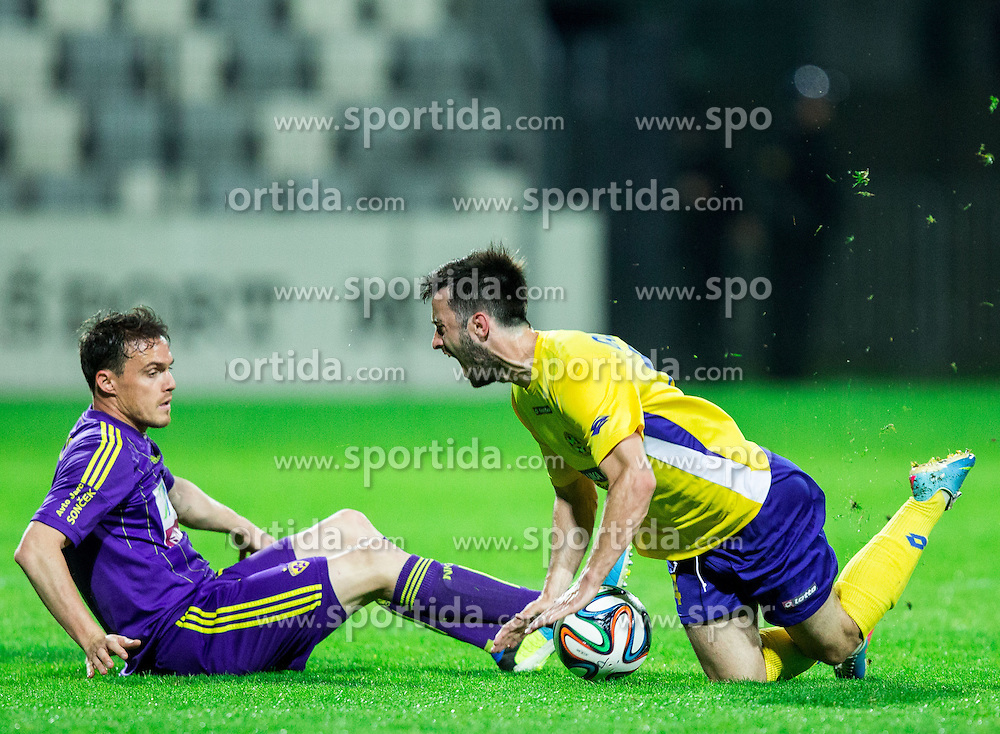 Ales Mejac #7 of Maribor vs Goran Galesic of Luka Koper during football match between FC Luka Koper and NK Maribor in 30th Round of Prva liga Telekom Slovenije 2013/14, on April 26, 2014 in Stadium Bonifika, Koper, Slovenia. Photo by Vid Ponikvar / Sportida