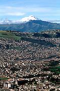 ECUADOR, QUITO, SKYLINE view of city and Cotopaxi Volcano