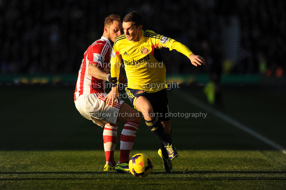 Sunderland's Adam Johnson breaks away from Stoke's Marko Arnautovic.  Barclays Premier league, Stoke city v Sunderland at the Britannia stadium in Stoke on Trent, England on Saturday 23rd Nov 2013. pic by Andrew Orchard, Andrew Orchard sports photography,