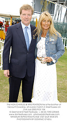 The HON.CHARLES & MRS PEARSON he is the brother of Viscount Cowdray, at a polo match in West Sussex on 21st July 2002.	PCE 154