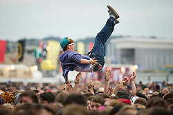 © London News Pictures. 24/08/2012. London, UK. A music fan being thrown in to the air as he watches 'You Me And Six' perform on day one of Reading Festival 2012 in Reading, Berkshire, UK on August 24, 2012. The three day event which attracts over 80,000 music fans opens officially today (Friday) and will headline The Cure, Kasabian and The Foo Fighters Photo credit : Ben Cawthra/LNP