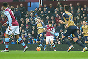 Aston Villa's Carles Gil battles for the ball with Arsenal's Nacho Monreal during the Barclays Premier League match between Aston Villa and Arsenal at Villa Park, Birmingham, England on 13 December 2015. Photo by Shane Healey.