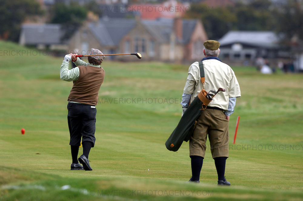 The PGA World Hickory Golf Open is being held at Gullane Golf Club on Thursday and Friday, 24th and 25th September 2009 featuring professional golf champions and amateurs in traditional 1930s period costume with six pre-1936 hickory shafted clubs in pencil golf bags...Picture shows a hickory golfer driving whilst another looks on.