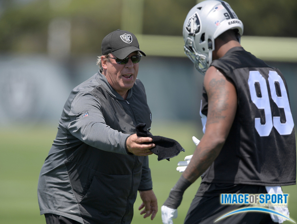 Oakland Raiders defensive line coach Mike Trgovac (left) and defensive end Arden Key (99) during rookie minicamp at the Raiders practice facility.