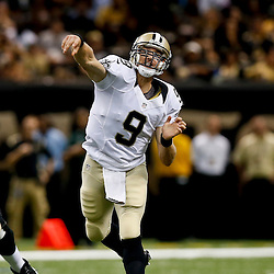 Aug 16, 2013; New Orleans, LA, USA; New Orleans Saints quarterback Drew Brees (9) throws against the Oakland Raiders during the first quarter of a preseason game at the Mercedes-Benz Superdome. Mandatory Credit: Derick E. Hingle-USA TODAY Sports
