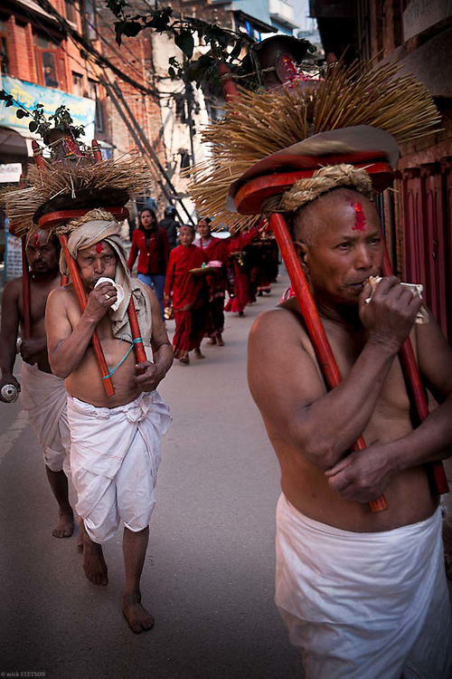 — Men attendants carrying holy water on their headdress precede the devotees as they walk to the temple. The water, taken from one of the holy rivers, purifies the path taken by the devotees, ensuring that they remain pure, uncontaminated, before attending the ceremony.