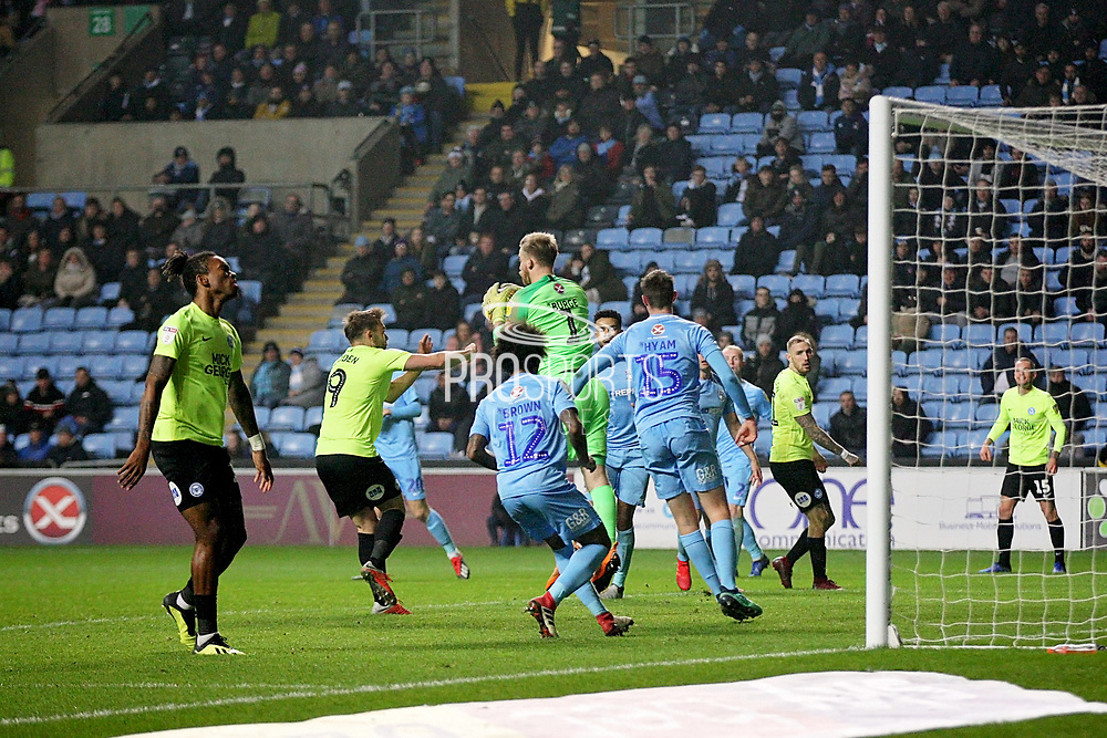 Coventry City goalkeeper Lee Burge (1) catches this cross in front of Peterborough United forward Matt Godden (9) during the EFL Sky Bet League 1 match between Coventry City and Peterborough United at the Ricoh Arena, Coventry, England on 23 November 2018.