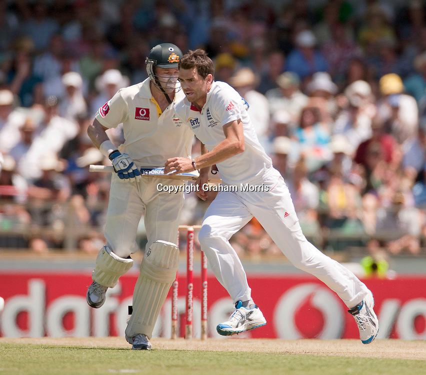 James Anderson runs infront of Michael Hussey to field off his own bowling during the third Ashes test match between Australia and England at the WACA (West Australian Cricket Association) ground in Perth, Australia. Photo: Graham Morris (Tel: +44(0)20 8969 4192 Email: sales@cricketpix.com) 18/12/10