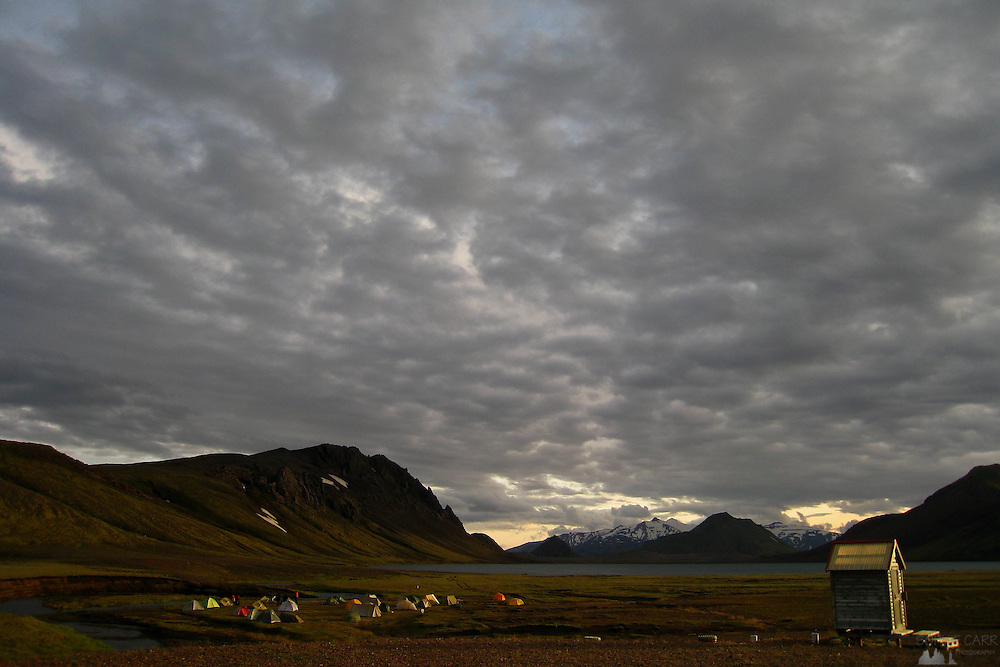 Campers at Álftavatn, one of the stops along the wonderful Laugavegur trail in southern Iceland, in the late evening sun in mid-summer.