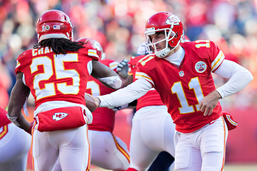 KANSAS CITY, MO - NOVEMBER 16:  Alex Smith #11 makes a hand off to Jamall Charles #25 of the Kansas City Chiefs and the Seattle Seahawks at Arrowhead Stadium on November 16, 2014 in Kansas City, Missouri.  The Chiefs defeated the Seahawks 24-20.  (Photo by Wesley Hitt/Getty Images) *** Local Caption *** Alex Smith; Jamaal Charles