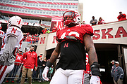Players enter for warmups before the Nebraska Huskers Spring Game on April 21, 2018. Photo by Ryan Loco.