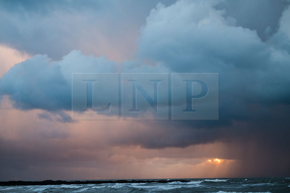 © Licensed to London News Pictures<br /> 26/10/2018. Aberystwyth, UK. Dark storm clouds gather broodingly over Cardigan Bay off Aberystwyth, threatening heavy rain and hail showers at the end of a day of bitingly cold northerly winds bringing the first taste of winter to much of the UK. Photo credit: Keith Morris/LNP