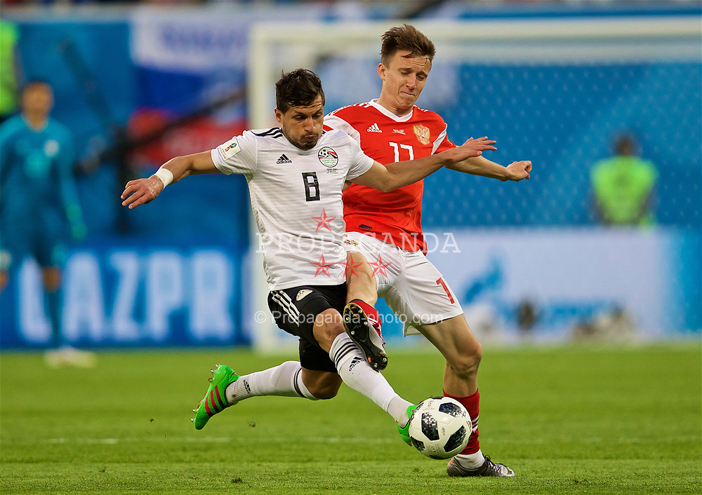 SAINT PETERSBURG, RUSSIA - Tuesday, June 19, 2018: Egypt's Tarek Hamed and Russia's Aleksandr Golovin during the FIFA World Cup Russia 2018 Group A match between Russia and Egypt at the Saint Petersburg Stadium. (Pic by David Rawcliffe/Propaganda)