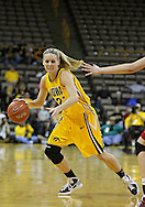 December 09 2010: Iowa forward Kelsey Cermak (22) drives with the ball during the first half of their NCAA basketball game at Carver-Hawkeye Arena in Iowa City, Iowa on December 9, 2010. Iowa defeated Iowa State 62-40 in the Hy-Vee Cy-Hawk Series rivalry game.