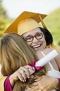 Graduate Hugging Woman