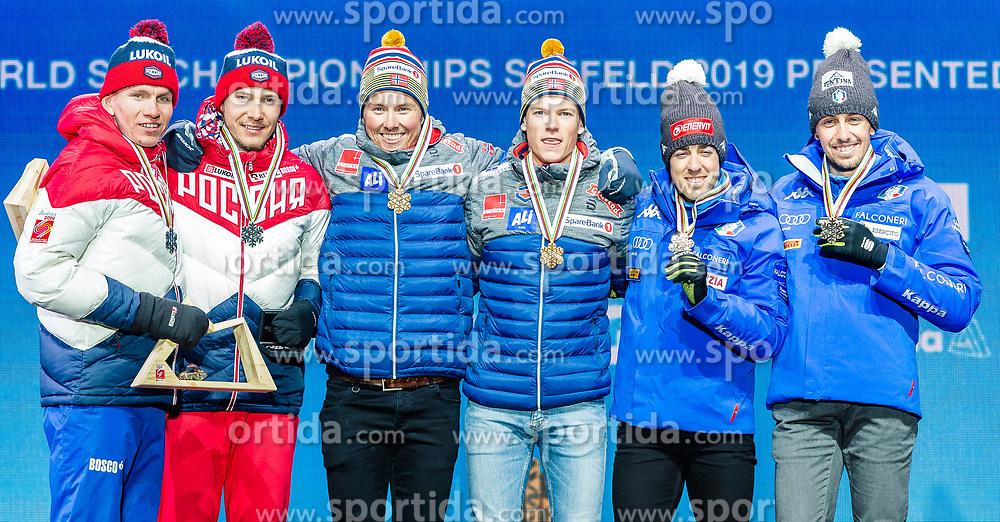 24.02.2019, Medal Plaza, Seefeld, AUT, FIS Weltmeisterschaften Ski Nordisch, Seefeld 2019, Langlauf, Herren, Teambewerb, Siegerehrung, im Bild Silbermedaillengewinner Gleb Retivykh (RUS), Alexander Bolshunov (RUS), Weltmeister und Goldmedaillengewinner Johannes Hoesflot Klaebo (NOR), Emil Iversen (NOR), Bronzemedaillengewinner Federico Pellegrino (ITA), Francesco De Fabiani (ITA), Bronce medalist // Silver medalist Gleb Retivykh Alexander Bolshunov of Russian Federation World champion and Gold medalist Johannes Hoesflot Klaebo Emil Iversen of Norway and Bronce medalist Federico Pellegrino Francesco De Fabiani of Italy during the winner ceremony for the men's cross country team competition of FIS Nordic Ski World Championships 2019 at the Medal Plaza in Seefeld, Austria on 2019/02/24. EXPA Pictures © 2019, PhotoCredit: EXPA/ Stefan Adelsberger
