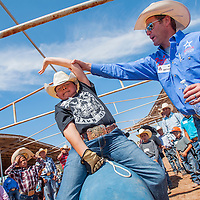 070313       Cable Hoover<br /> <br /> Jake Silago, center, gets some bull riding pointers from professional rider Fred Boettcher during a PRCA camp at the Navajo Nation Fairground in Window Rock Wednesday.