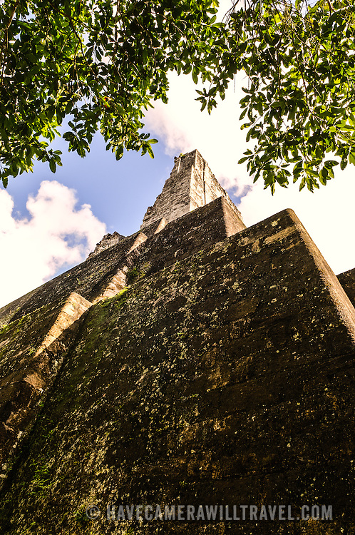 Looking up from the base of Temple 3 in the Tikal Maya ruins in northern Guatemala, now enclosed in the Tikal National Park.