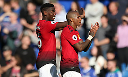 Manchester United's Paul Pogba (left) and Manchester United's Ashley Young applaud the fans after the final whistle