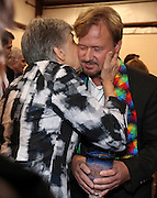 The Rev. Frank Schaefer a United Methodist minister was convicted by a church trial of breaking church law by officiating at his son's same-sex marriage in 2007. Janet Wolf from Nashville TN, gives Rev. Schaefer as kiss while he offers communion after learning his faith a 30-day suspension.