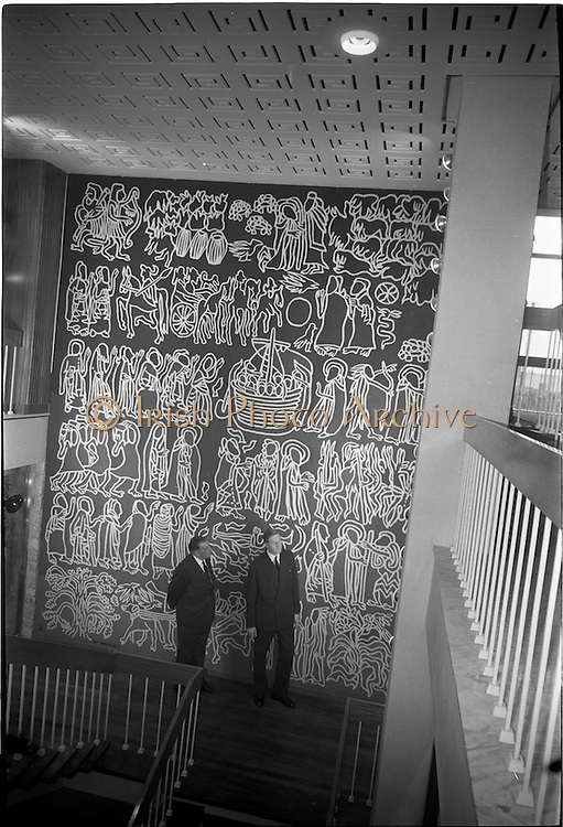 "01/06/1964<br /> 06/01/1964<br /> 01 June 1964<br /> Opening of new Marketing Headquarters of P.J. Carroll and Company Ltd. at Grand Parade on the Grand Canal, Dublin. The premises were officially opened by Taoiseach Sean Lemass. Picture shows Mr. Don Carroll, (right) Chairman of P.J. Carroll and Co. Ltd. describing the tapestry, ""Brendan the Navigator"" in the new building to Sean Lemass."