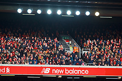 LIVERPOOL, ENGLAND - Saturday, February 9, 2019: Liverpool supporters in the winter sunshine and under floodlights in the upper tier of the Anfield Road stand during the FA Premier League match between Liverpool FC and AFC Bournemouth at Anfield. (Pic by David Rawcliffe/Propaganda)