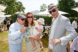 Left to right, SIR JACKIE STEWART, LUCY YEOMANS, her daughter RED and JASON BROOKS at the Cartier 'Style et Luxe' part of the Goodwood Festival of Speed, Goodwood House, West Sussex on 14th July 2013.