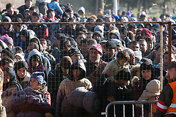 Licensed to London News Pictures. 03/11/2015. Sentilj, Slovenia. Migrants are waiting to enter Austria at the border crossing in Sentilj, Slovenia. Photo: Marko Vanovsek/LNP