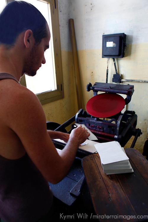 Central America, Cuba, Caibarien. Print Shop Press Operator in Caibarien.