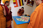 Tibetian monks from the Sera Je monastery in Indian exile creating a medicinal green Tara Mandala in Fribourg, Switzerland. Moines boudhistes du monastère indien Sera Je créant durant une semaine un mandala de sable medicinal à Fribourg. © Romano P. Riedo