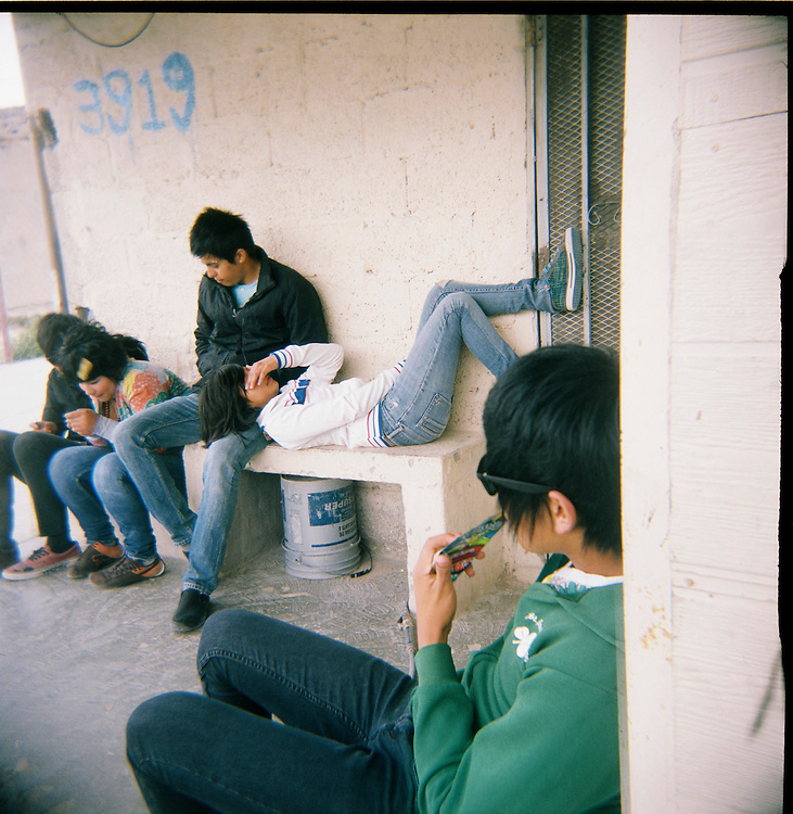 """Members of the """"Toke Azul Band"""" and their friends hang out in the Diaz Ordaz colonia in Ciudad Juarez, Chihuahua Mexico on April 28, 2010. ."""