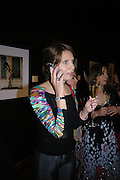 Katia Neverova. 4 Inches, A  Photographic Auction in aid of the Elton John Aids Foundation hosted by Tamara Mellon and Arnaud Bamberger. Christie's. 8 King St. London. 25 May 2005. ONE TIME USE ONLY - DO NOT ARCHIVE  © Copyright Photograph by Dafydd Jones 66 Stockwell Park Rd. London SW9 0DA Tel 020 7733 0108 www.dafjones.com