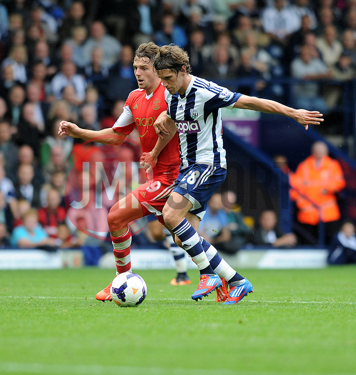 Southampton's Jay Rodriguez attacks inside the box with pressure from West Bromwich Albion's Billy Jones  - Photo mandatory by-line: Alex James/JMP - Tel: Mobile: 07966 386802 17/08/2013 - SPORT - FOOTBALL - The Hawthorns - West Bromwich -  West Brom V Southampton - Barclays Premier League