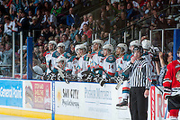 KELOWNA, CANADA - APRIL 25: The # of the Kelowna Rockets stand on the bench against the Portland Winterhawks on April 25, 2014 during Game 5 of the third round of WHL Playoffs at Prospera Place in Kelowna, British Columbia, Canada. The Portland Winterhawks won 7 - 3 and took the Western Conference Championship for the fourth year in a row earning them a place in the WHL final.  (Photo by Marissa Baecker/Getty Images)  *** Local Caption *** Bench;