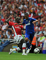 Photo: Tony Oudot/Richard Lane Photography.  Arsenal v Real Madrid. Emirates Cup. 03/08/2008. <br /> Robinho of Real Madrid is tackled by Bacary Sagna of Arsenal