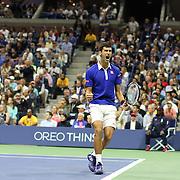 Novak Djokovic, Serbia, celebrates a break while winning the Men's Singles Final against Roger Federer, Switzerland, during the US Open Tennis Tournament, Flushing, New York, USA. 13th September 2015. Photo Tim Clayton
