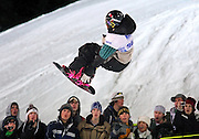 SHOT 1/26/08 7:41:40 PM - Snowboarder J.J. Thomas of Breckenridge, Co. captures the attention of the crowd during the Snowboard Superpipe elimination event Saturday January 26, 2008 at Winter X Games Twelve in Aspen, Co. at Buttermilk Mountain. Thomas, a former bronze medalist at the Olympics, didn't qualify for the finals. The 12th annual winter action sports competition features athletes from across the globe competing for medals and prize money is skiing, snowboarding and snowmobile. Numerous events were broadcast live and seen in more than 120 countries. The event will remain in Aspen, Co. through 2010..(Photo by Marc Piscotty / © 2008)
