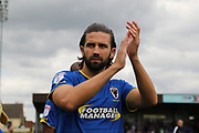 AFC Wimbledon defender George Francomb (7) clapping during the EFL Sky Bet League 1 match between AFC Wimbledon and Shrewsbury Town at the Cherry Red Records Stadium, Kingston, England on 12 August 2017. Photo by Matthew Redman.