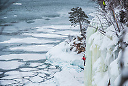 Jon Jugenheimer ice climbs on the far north side of Grand Island on Lake Superior at Munising, Michigan.