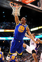 Jan. 2, 2012; Phoenix, AZ, USA; Golden State Warriors forward Dominic McGuire (5) dunks the ball against the Phoenix Suns guard Shannon Brown (26) during the first half at the US Airways Center. Mandatory Credit: Jennifer Stewart-US PRESSWIRE.