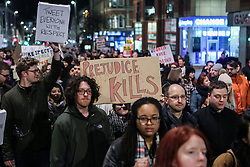 © Licensed to London News Pictures. 30/01/2017. Leeds, UK. Anti racism campaigners in Leeds take part in a protest against President Donald Trump's decision to ban people from certain Islamic countries from entering the United States. The newly elected president has drawn much criticism for his actions so far with people protesting against him all around the globe.  Photo credit : Ian Hinchliffe/LNP