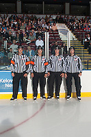 KELOWNA, CANADA - SEPTEMBER 21:  Steve Papp and Kevin Bennett, referees and Ward Pateman and Mike Langin, linesmen, stand on the ice  at the Kelowna Rockets on September 21, 2013 at Prospera Place in Kelowna, British Columbia, Canada (Photo by Marissa Baecker/Shoot the Breeze) *** Local Caption ***