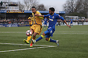 Sutton United Craig Eastmond (15) tackles AFC Wimbledon striker Andy Barcham (17) during The FA Cup match between Sutton United and AFC Wimbledon at Gander Green Lane, Sutton, United Kingdom on 7 January 2017. Photo by Stuart Butcher.