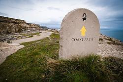 Stone Coast Path sign on the Isle of Portland, Dorset, England, UK.