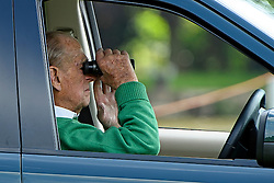 © London News Pictures. 15/05/2016. Windsor, UK. PRINCE PHILIP, THE DUKE OF EDINBURGH, using binoculars to watch driven dressage on The final day of the 2016 Royal Windsor Horse Show, held in the grounds of Windsor Castle in Berkshire, England. This years event is part of HRH Queen Elizabeth II's 90th birthday celebrations.  Photo credit: Ben Cawthra/LNP